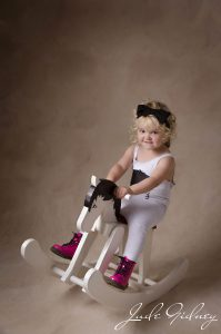 Photograph of a toddler on a rocking horse in Oldham